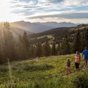 family hiking at sunset at black powder pass