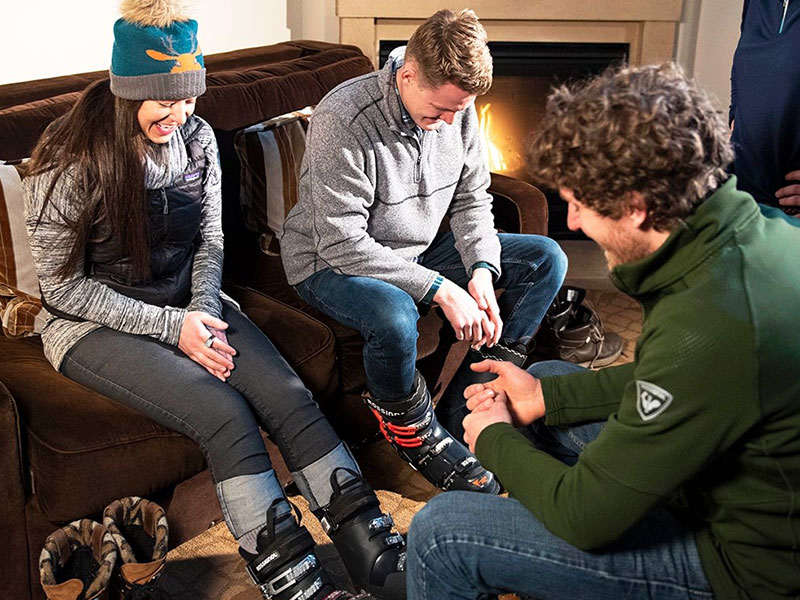 Ski Butlers tech adjusting rental boots with guests